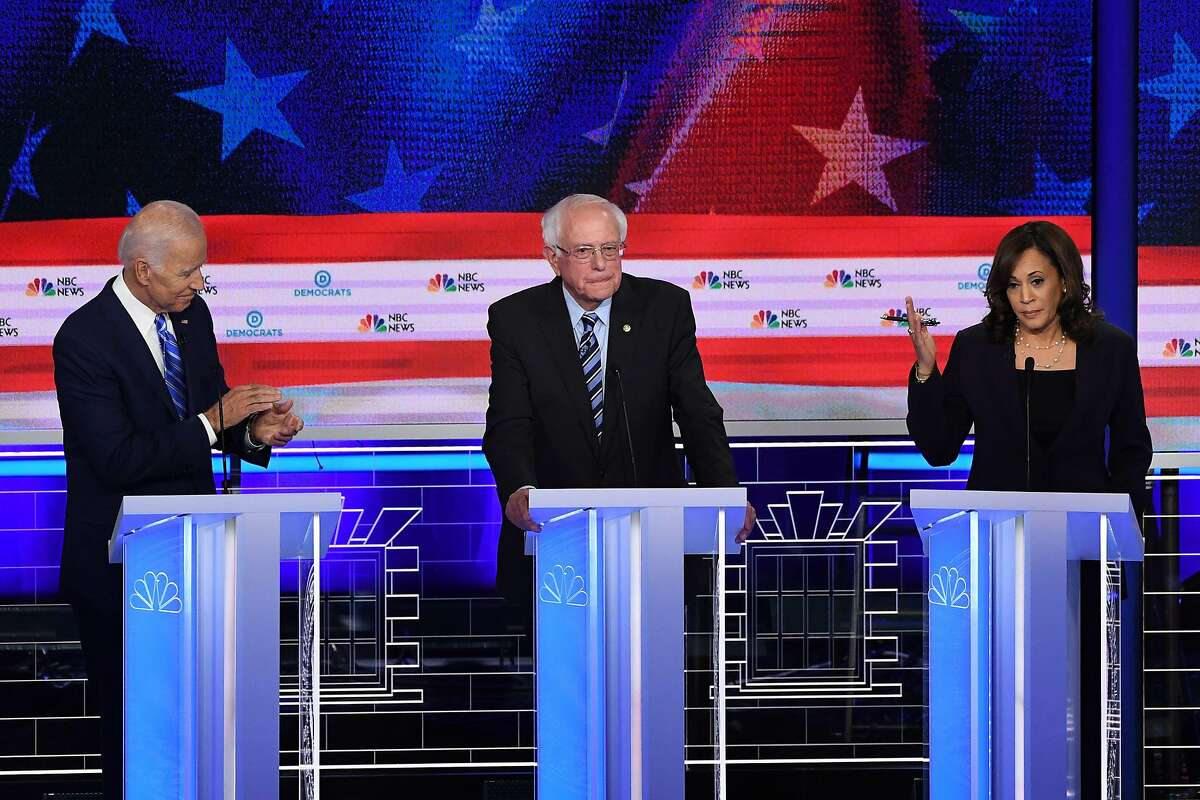 Democratic presidential hopefuls US Senator for California Kamala Harris (R) speaks alongside former US Vice President Joseph R. Biden Jr. (L) and US Senator for Vermont Bernie Sanders during the second Democratic primary debate of the 2020 presidential campaign season hosted by NBC News at the Adrienne Arsht Center for the Performing Arts in Miami, Florida, June 27, 2019. (Photo by SAUL LOEB / AFP)SAUL LOEB/AFP/Getty Images