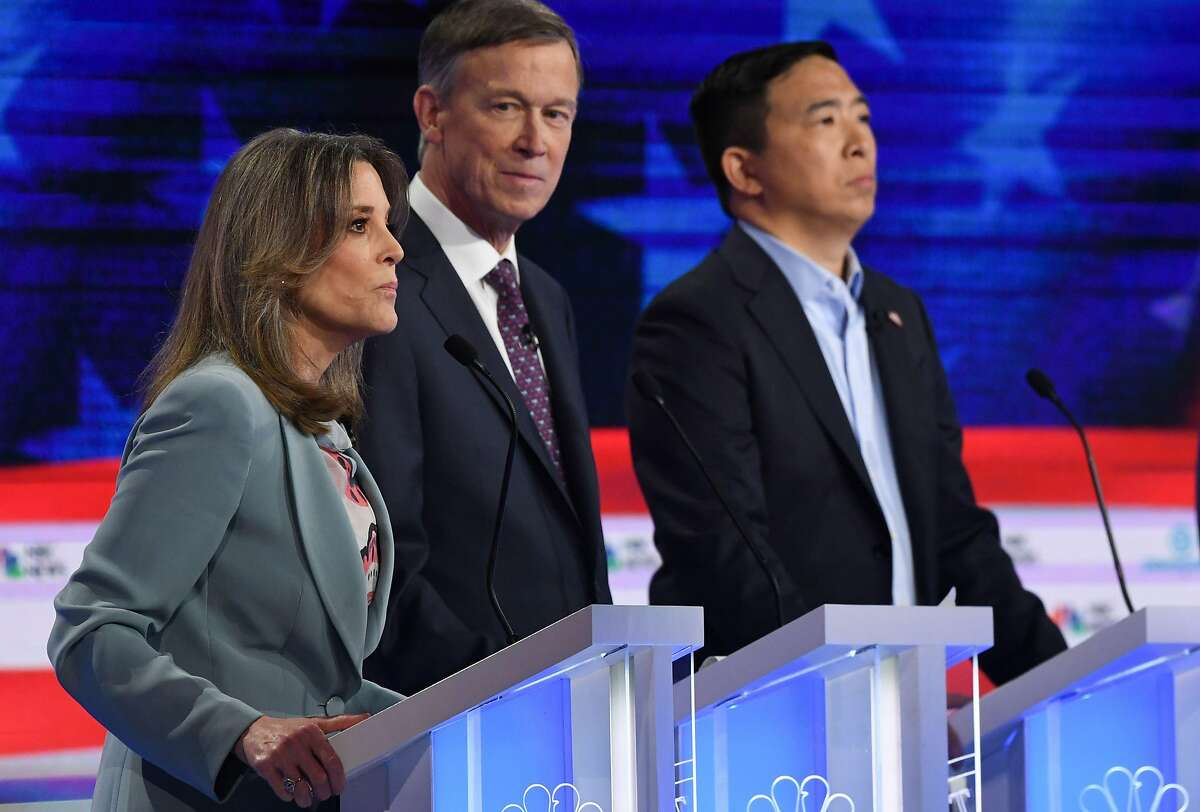 Democratic presidential hopefuls (L-R) US author and writer Marianne Williamson, Former Governor of Colorado John Hickenlooper and US entrepreneur Andrew Yang participate in the second Democratic primary debate of the 2020 presidential campaign season hosted by NBC News at the Adrienne Arsht Center for the Performing Arts in Miami, Florida, June 27, 2019. >>Memes show the internet's reaction to Williamson in the debate.