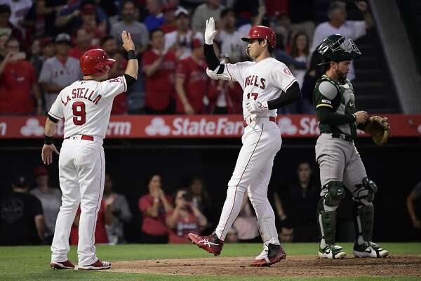 Brand-new Angels sock it to A's, 8-3