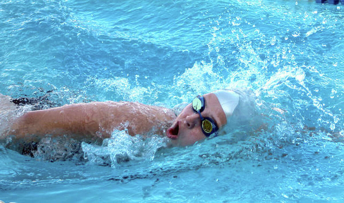 Leah Pohlman of Summers Port swims the 15-18 girls 200-yard freestyle in Thursday night's home dual meet against the Splash City Gators of Collinsville. She later won the 15-18 girls 100 breaststroke.