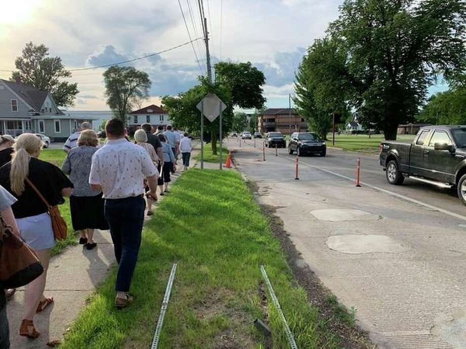 FILE — Members of the Midland Planning Commission and Downtown Development Authority, along with members of the public, tour the area of downtown Midland affected by the Buttles Street 'road diet' on June 27, 2019.(Mitchell Kukulka/Mitchell.Kukulka@mdn.net)
