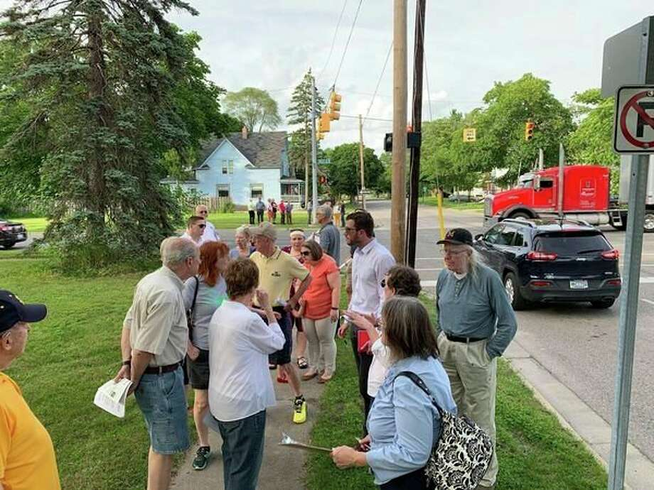 Members of the Midland Planning Commission and Downtown Development Authority, along with members of the public, tour the area of downtown Midland affected by the Buttles Street 'road diet' on June 27, 2019. (Mitchell Kukulka/Mitchell.Kukulka@mdn.net)