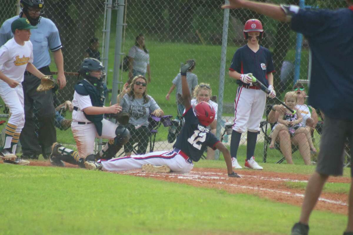 NASA All-Star Dylan Proctor finishes his daring run to home plate on a wild pitch that only trickled a short distance from home plate. The gutsy play got the guys within one.