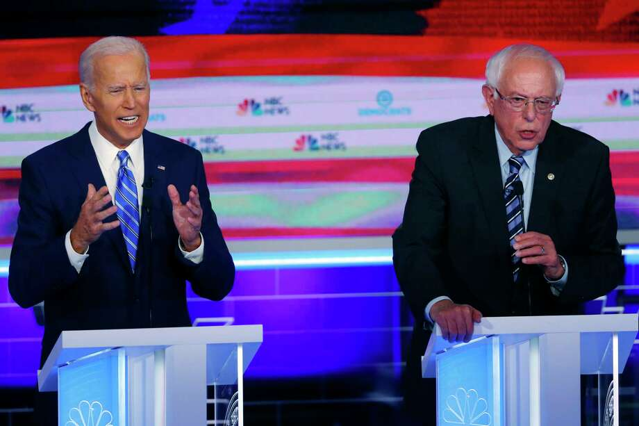 Democratic presidential candidates former vice president Joe Biden and Sen. Bernie Sanders, I-Vt., speak at the same time during the Democratic primary debate hosted by NBC News at the Adrienne Arsht Center for the Performing Arts, Thursday, June 27, 2019, in Miami. Photo: Wilfredo Lee, AP / Copyright 2019 The Associated Press. All rights reserved.