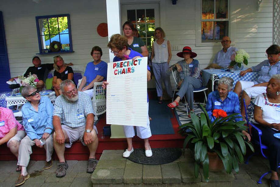 Dana Ryan, Democratic central committee chair of Morgan County, explains the need for volunteers to get involved in elections at whatever level they feel comfortable during the Morgan County Democrats garden party fundraiser Thursday. Photo: Rosalind Essig | Journal-Courier