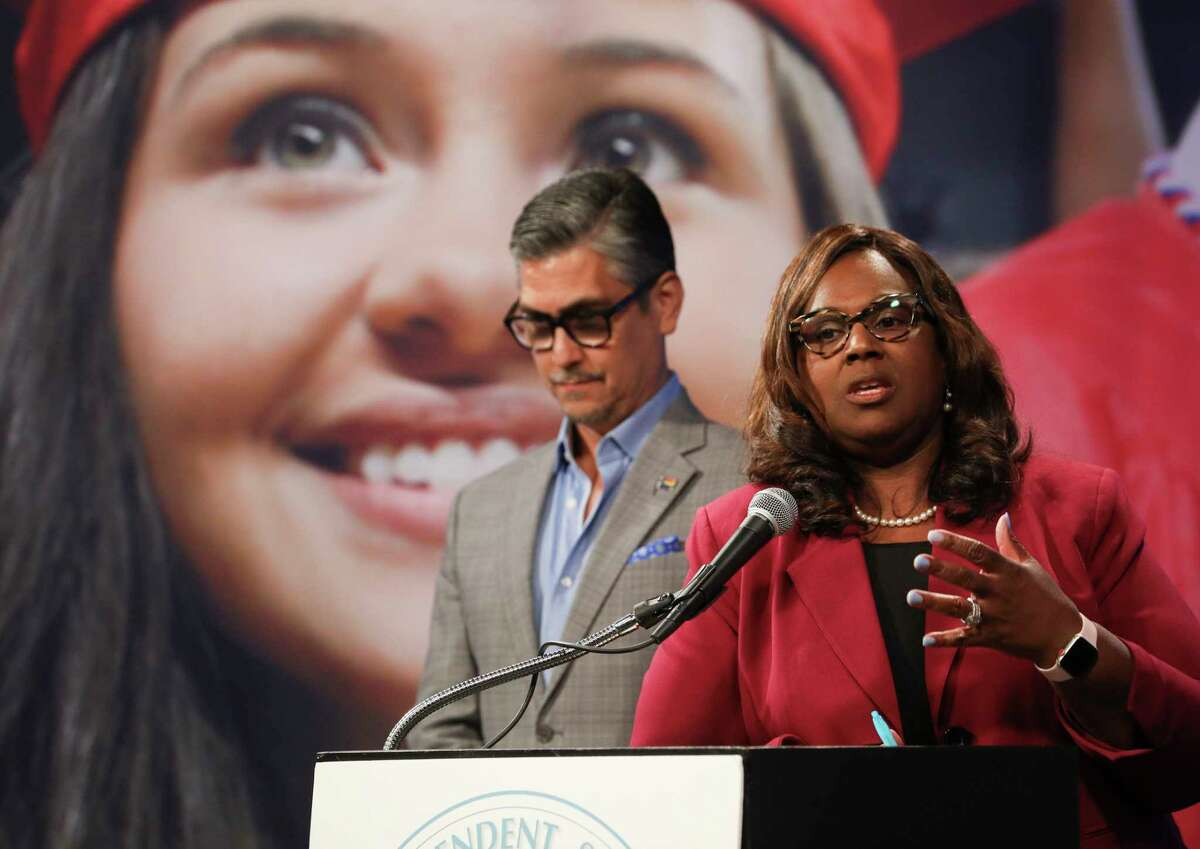 Chief Financial Officer Rene Barajas, left, and Houston Independent School District Interim Superintendent Grenita Lathan talk about proposed salary increases for district employees during a press conference in Houston, Tuesday, June 25, 2019.
