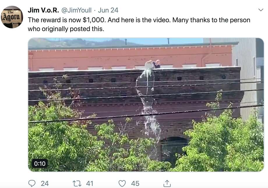 A video has spread across Twitter showing a man in San Francisco dropping water from a rooftop onto a homeless woman on the ground below. SFPD says the incident is under investigation. Photo: Screen Capture From Twitter: Jim V.o.R. @JimYoull
