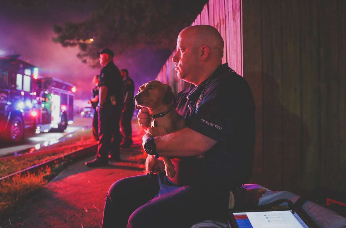 Cy-Fair volunteer firefighters rescued one of two family dogs from a house fire early Friday in the 13200 block of Fountaincrest.