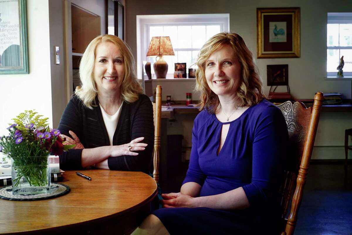 Avon Scherff, left, director, employee benefit services at Hanys Benefit Services, and Kate Ziehm, president of Morning Ag Clips, pose for a photo at the Morning Ag Clips office on Wednesday, May 8, 2019, in Greenwich, N.Y. (Paul Buckowski/Times Union)
