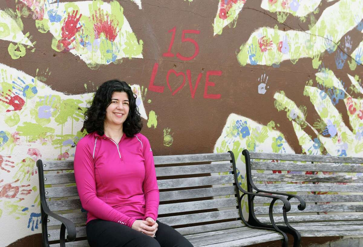 15-LOVE's executive director Amber Marino sits for a portrait in the garden on Wednesday, May 22, 2019 at 15-LOVE in Albany, NY. (Phoebe Sheehan/Times Union)