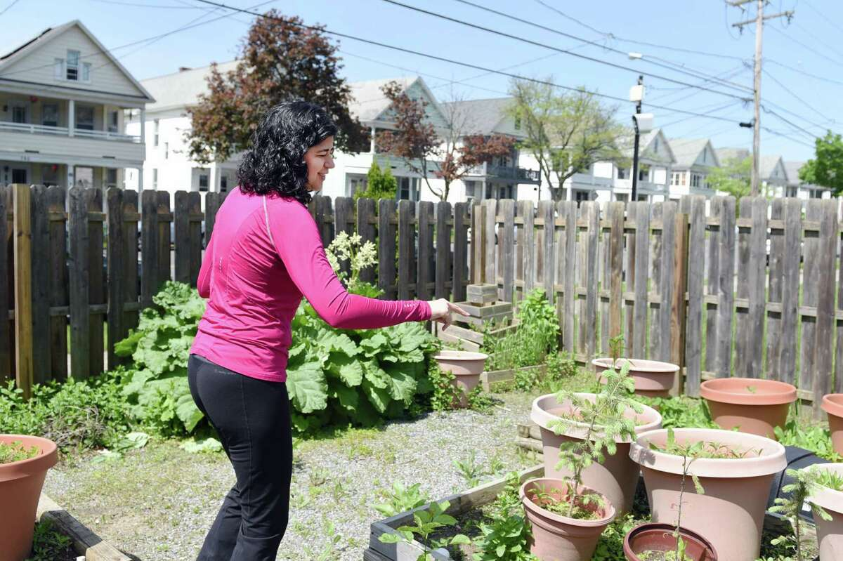15-LOVE's executive director Amber Marino walks around the garden and explains what plants the children will be growing on Wednesday, May 22, 2019 at 15-LOVE in Albany, NY. (Phoebe Sheehan/Times Union)