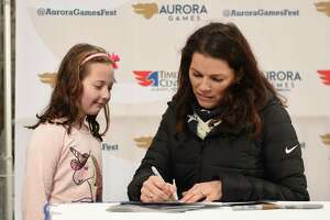 Sophia Brothers, 8, of Clifton Park gets an autograph by two-time Olympic figure skating medalist Nancy Kerrigan during a special appearance at the Empire State Plaza on Thursday, Feb. 7, 2019 in Albany, N.Y. Kerrigan serves as the Figure Skating Chair on the Aurora Games Advisory Board. (Lori Van Buren/Times Union)