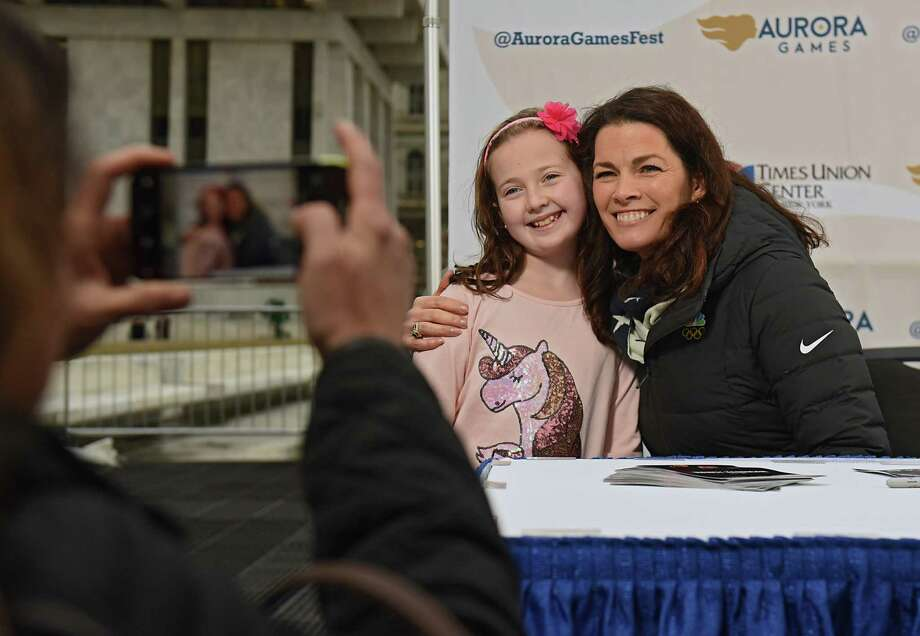 Laura Brothers takes a photo of  her daughter Sophia, 8, of Clifton Park as she gets an autograph by two-time Olympic figure skating medalist Nancy Kerrigan during a special appearance at the Empire State Plaza on Thursday, Feb. 7, 2019 in Albany, N.Y. Kerrigan serves as the Figure Skating Chair on the Aurora Games Advisory Board. (Lori Van Buren/Times Union) Photo: Lori Van Buren / 40046113A