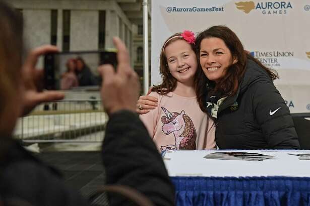 Laura Brothers takes a photo of her daughter Sophia, 8, of Clifton Park as she gets an autograph by two-time Olympic figure skating medalist Nancy Kerrigan during a special appearance at the Empire State Plaza on Thursday, Feb. 7, 2019 in Albany, N.Y. Kerrigan serves as the Figure Skating Chair on the Aurora Games Advisory Board. (Lori Van Buren/Times Union)