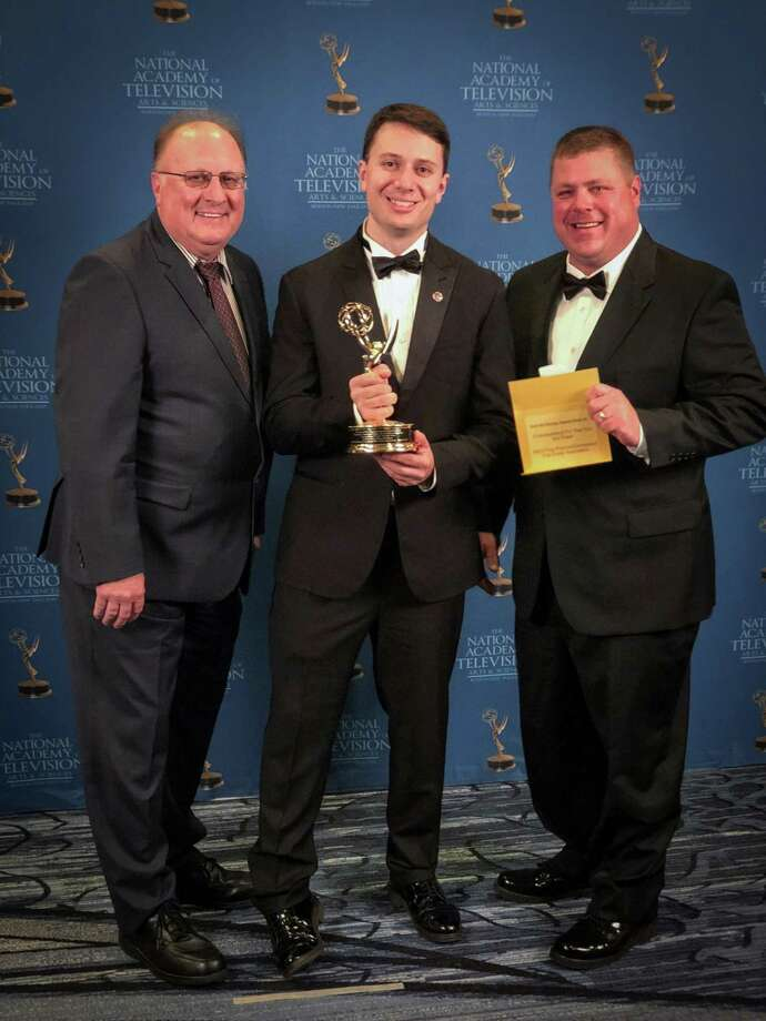 """The """"See You Out There"""" public service announcement launched by the Everyday Hero CT volunteer firefighter recruitment campaign in April 2018 won a Boston/New England Regional Emmy Award from the National Academy of Television Arts and Sciences. Shown, from left, are Hebron Fire Chief Nick Wallick, PSA director/producer and Hebron volunteer firefighter Matthew Troy, and Glastonbury Deputy Chief Dave Thurz, fire coordinator for the film. Photo: Contributed Photo"""