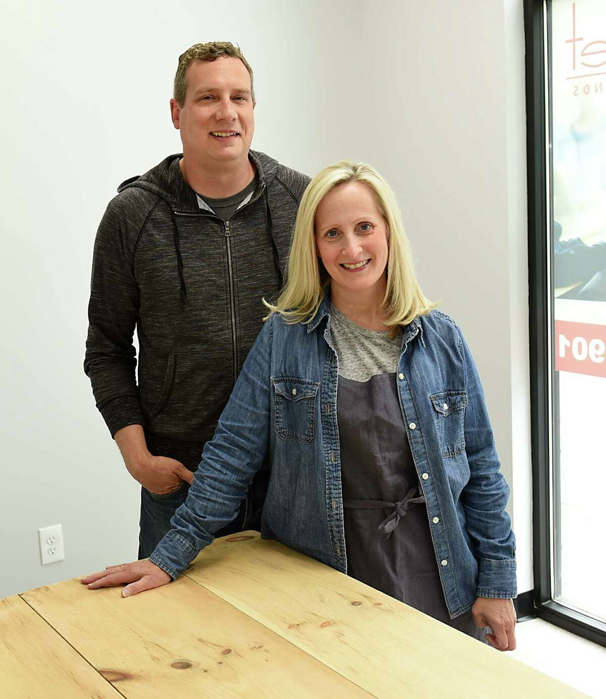Bake for You Co-owners Justin Carey and Linda Kindlon stand in their store on Friday, May 17, 2019 in Slingerlands, N.Y. (Lori Van Buren/Times Union)