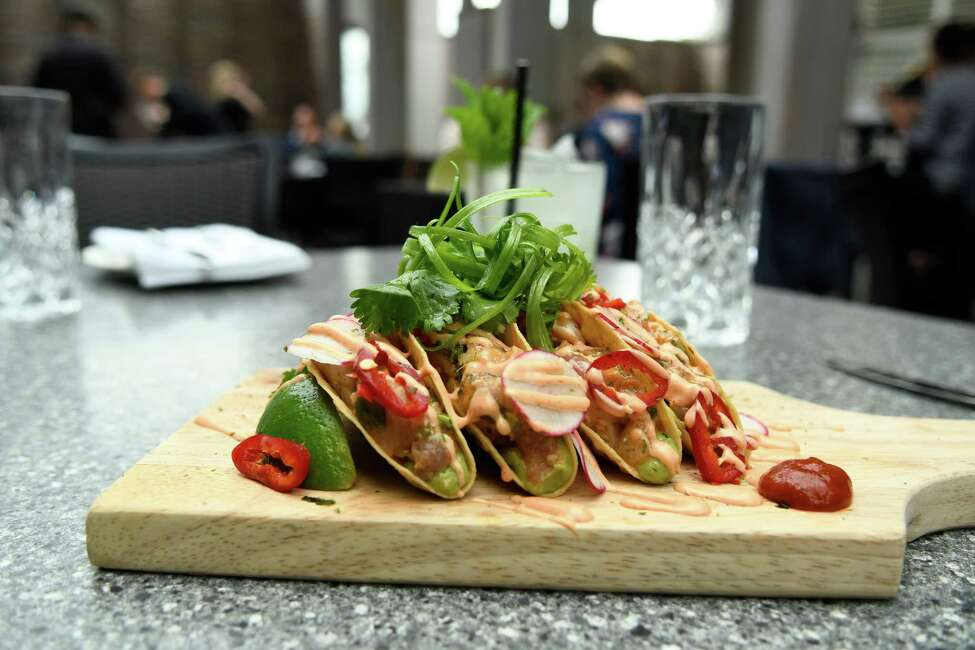 Hamachi Tartare Tacos are seen on Friday, May 24, 2019 on the Patio at 15 Church in Saratoga Springs, N.Y. (Jenn March, Special to the Times Union )