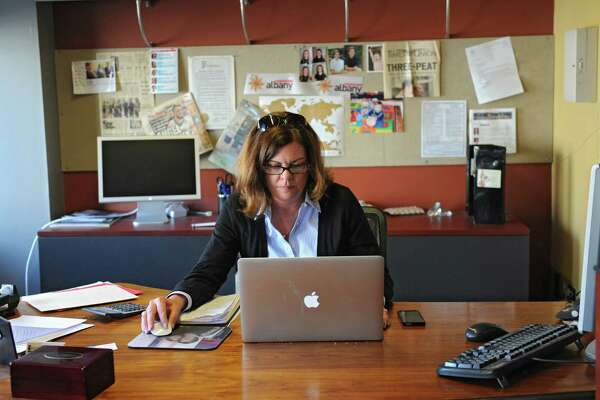 Beehive owner Tracy Metzger works at Beahive, a coworking space located on Broadway on Wednesday, March 30, 2016 in Albany, N.Y. (Lori Van Buren / Times Union)