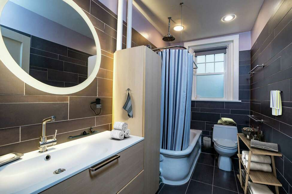 Bathroom of an Albany condo that was featured as a January House of the Week in Spaces. Interior photos have been digitally staged. (Photos by Robert Kristel)
