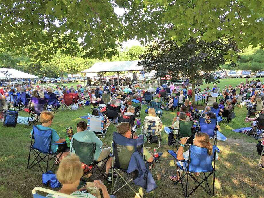 The crowd relaxes on camp chairs listening to the Waterbury Symphony at a 2018 concert. Photo: WSO / Contributed Photo