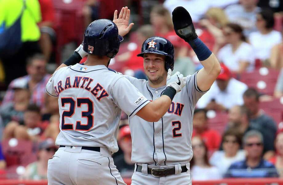 CINCINNATI, OHIO - JUNE 19:  Michael Brantley #23 of the Houston Astros celebrates with Alex Bregman #2 after hitting a home run in the sixth inning against the Cincinnati Reds at Great American Ball Park on June 19, 2019 in Cincinnati, Ohio. (Photo by Andy Lyons/Getty Images) Photo: Andy Lyons / Andy Lyons/Getty Images / 2019 Getty Images