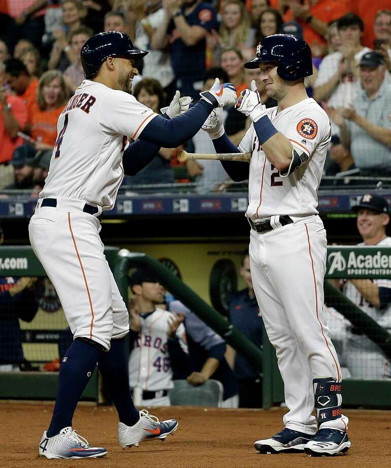 HOUSTON, TEXAS - JUNE 26: George Springer #4 of the Houston Astros receives thumbs up from Alex Bregman #2 after hitting a first inning home run against the Pittsburgh Pirates at Minute Maid Park on June 26, 2019 in Houston, Texas. (Photo by Bob Levey/Getty Images) Photo: Bob Levey / Bob Levey/Getty Images / 2019 Getty Images