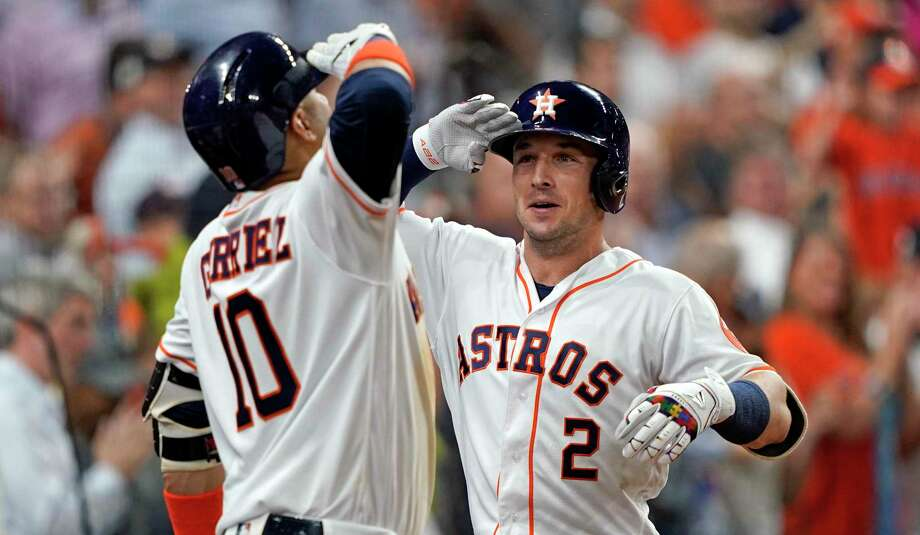 Houston Astros' Alex Bregman (2) celebrates with Yuli Gurriel (10) after hitting a home run against the Pittsburgh Pirates during the sixth inning of a baseball game Tuesday, June 25, 2019, in Houston. (AP Photo/David J. Phillip) Photo: David J. Phillip / David J. Phillip/Associated Press / Copyright 2019 The Associated Press. All rights reserved