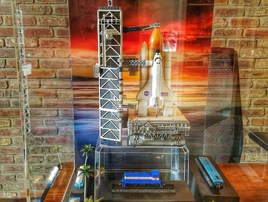 A NASA space shuttle replica surrounded by miniature train cars is on display at the Tomball Railroad Depot Museum as part of an exhibit to honor the 50th anniversary of the Apollo 11 moon landing. Photo: Courtesy Of The City Of Tomball