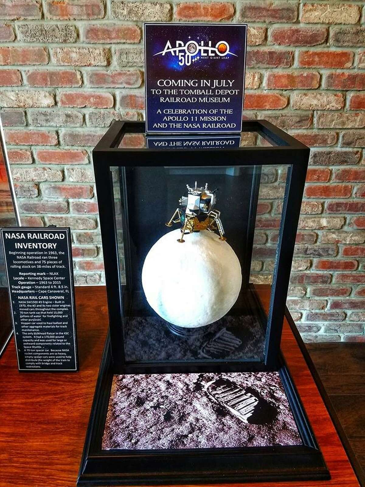 A diorama on display at the Tomball Railroad Depot Museum features a replica of Apollo 11's lunar landing, which occurred on July 20, 1969.
