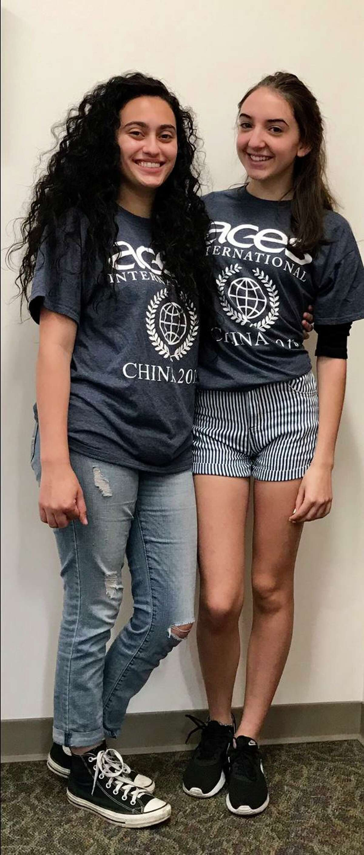 East Haven High School junior AvaRose Anastasio and sophomore Alexis Ferreira, music students at ACES ECA in New Haven, on their return from a recent study tour to China.
