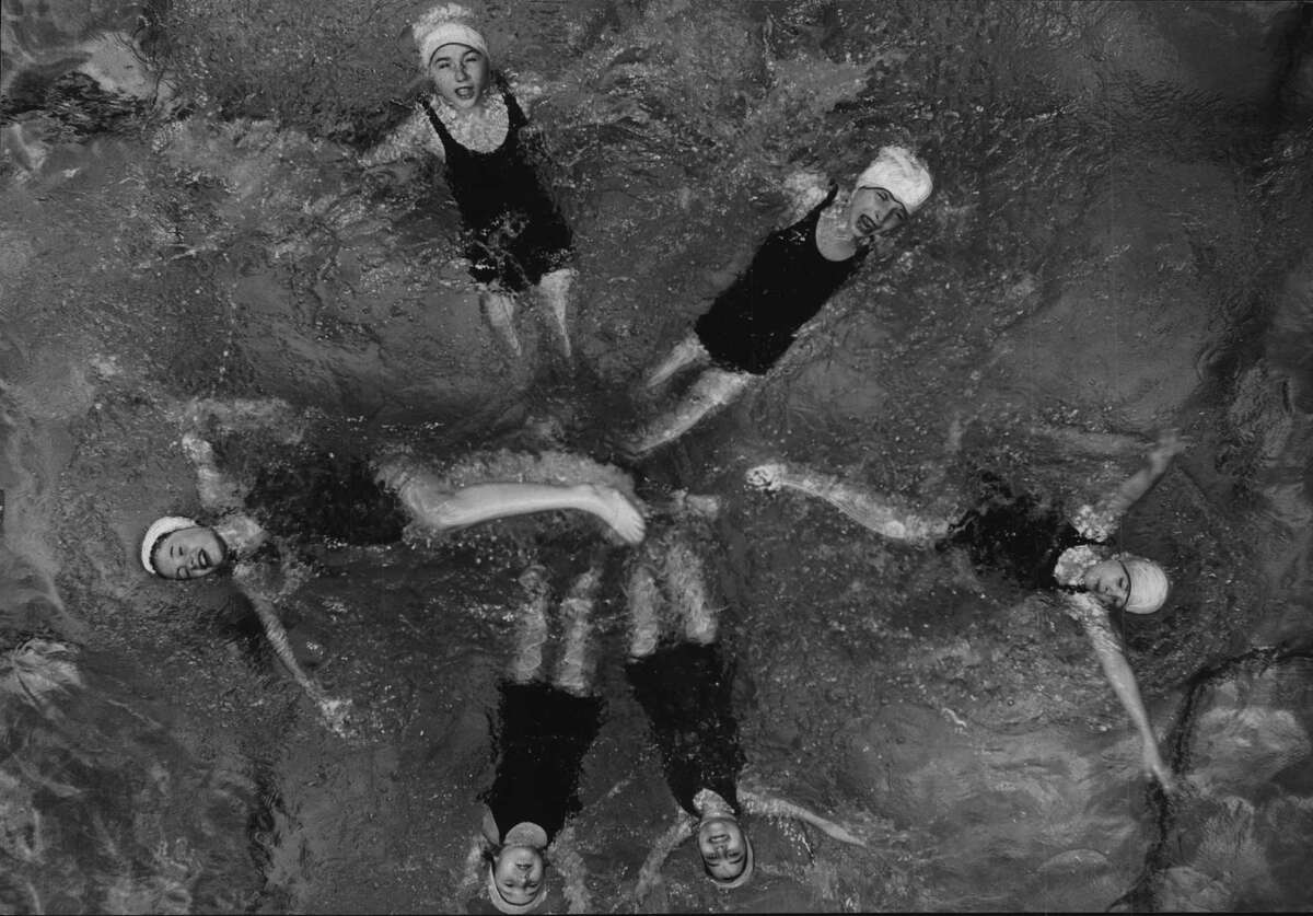 YWCA Albany, Fancy swimming, A class of young swimmers at the YWCA form a star in the water of the Y pool. The swimmers are Elleny Lyons, Dorothy Long, Teresa Tricomi, Marilyn Darrow, Ruth Donner and Sally Garlick. Mrs. Helen Moody was their instructor. January 30, 1949 (Times Union Archive)