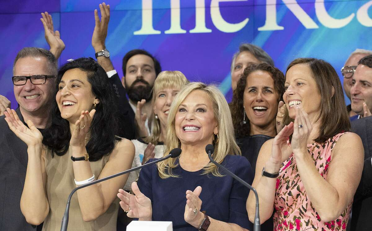 Julie Wainwright, center, CEO of The RealReal, celebrates her company's IPO at the Nasdaq opening bell, Friday, June 28, 2019 in New York. The online reseller of luxury brand clothing and accessories is based in San Francisco. With her are Rati Levesque, left, Chief Operating Officer, and Adena Friedman, right, President and CEO of Nasdaq. (AP Photo/Mark Lennihan)