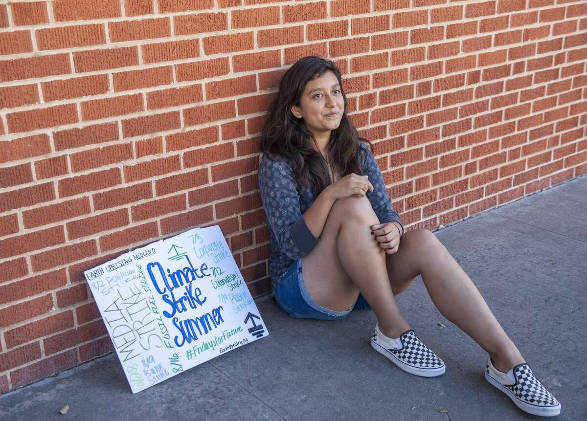 Estrella Villarreal, 16, Midland city coordinator for Earth Uprising, demonstrates outside the Midland Reporter-Telegram building 06/28/19 on the first of an eight-week campaign, FridaysforFuture, to raise awareness of climate change. Tim Fischer/Reporter-Telegram