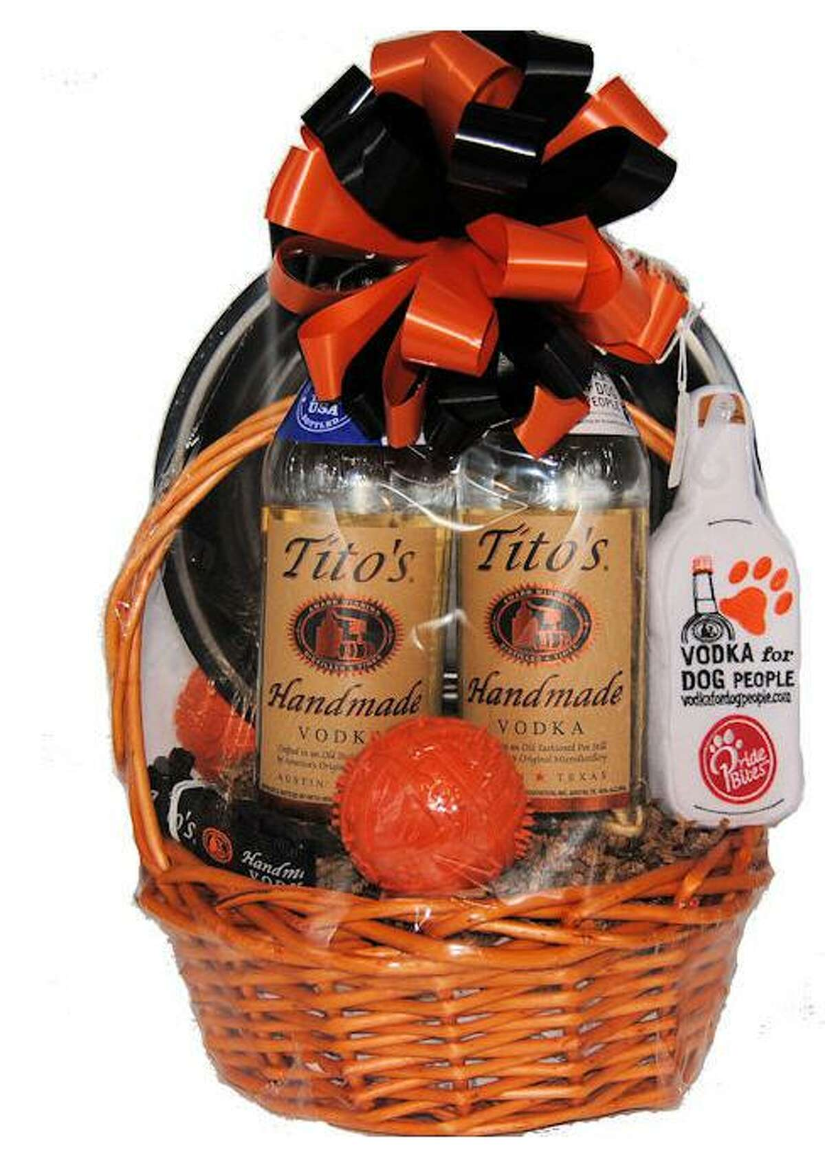 Tito Beveridge Tito's Handmade Vodka Austin has donated a basket for the live auction hosted by the Katy Veterans of Foreign Wars Post 9182. The auction summary notes that Tito is a dog lover as the basket includes items for dogs along with the vodka.