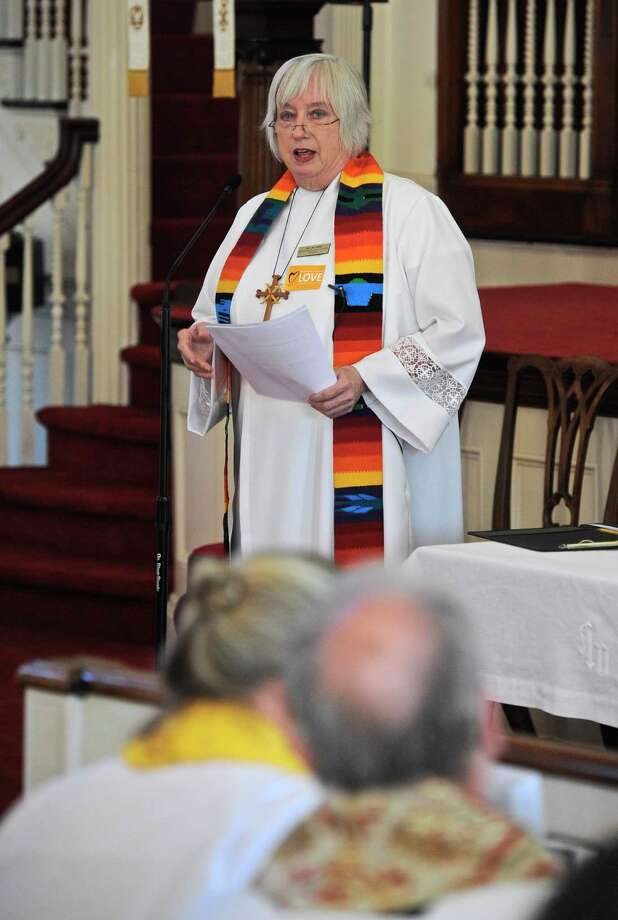Rev. Pat Kriss, pastor of the First Congregational Church of Danbury, speaks during a vigil in Danbury in 2016 to honor those killed in the nightclub shooting in Orlando, Fl. Photo: H John Voorhees III / Hearst Connecticut Media / The News-Times