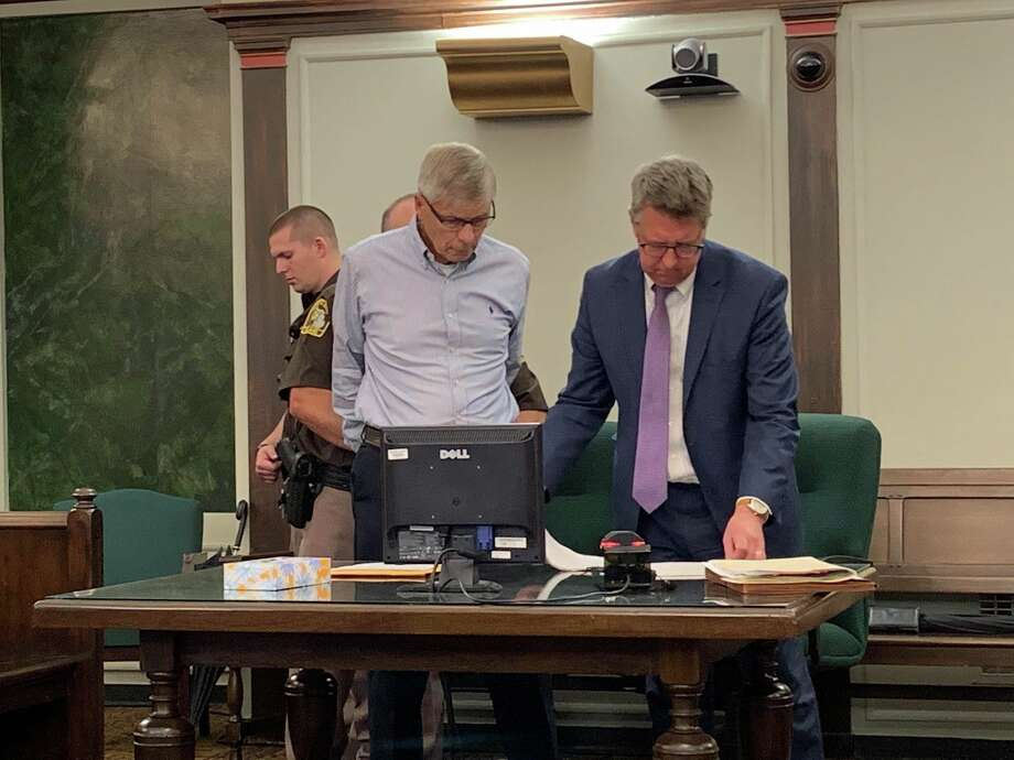 Gary Gatza, left, and his attorney Stephen Durance, right, look over court documents as Gatza is handcuffed by a court officer after being found guilty of four criminal charges, on June 28, 2019 in the 42nd Circuit Court. Gatza, 74, was sentenced to 72 months to 15 years in jail for operating while intoxicated and causing the Jan. 1, 2019, traffic crash that led to the death of Stanley Dulaney Jr. and the injury of the three passengers of Dulaney's vehicle. (Mitchell Kukulka/Mitchell.Kukulka@mdn.net) Photo: Mitchell Kukulka