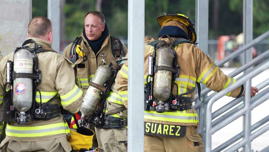 Lt. Lloyd Sanderford, of the Conroe Fire Department, directs participants in Conroe Fire Department's Fire Ops last year in this file photo. The city is allocating $415,000 to replace the department's bunker gear worn by firefighters. Photo: Jason Fochtman, Staff Photographer / Houston Chronicle / © 2018 Houston Chronicle