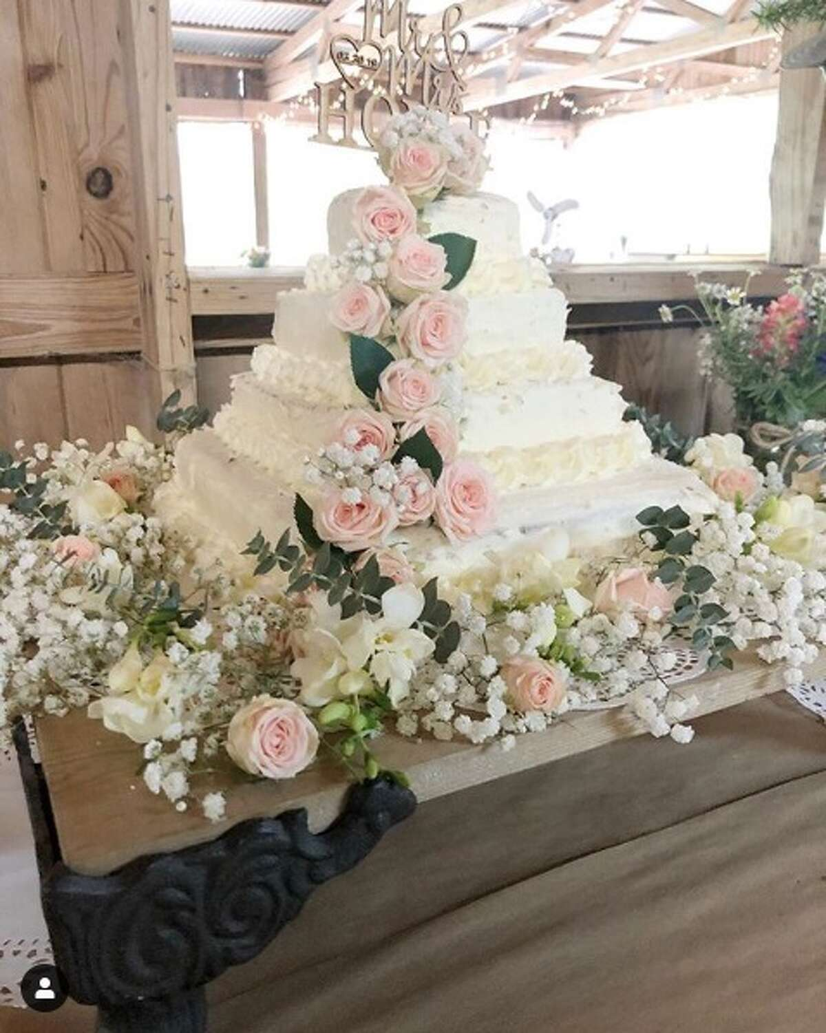 @cottagefarmhouse posted a photo of a DIY wedding cake that only cost a bride and groom $50.