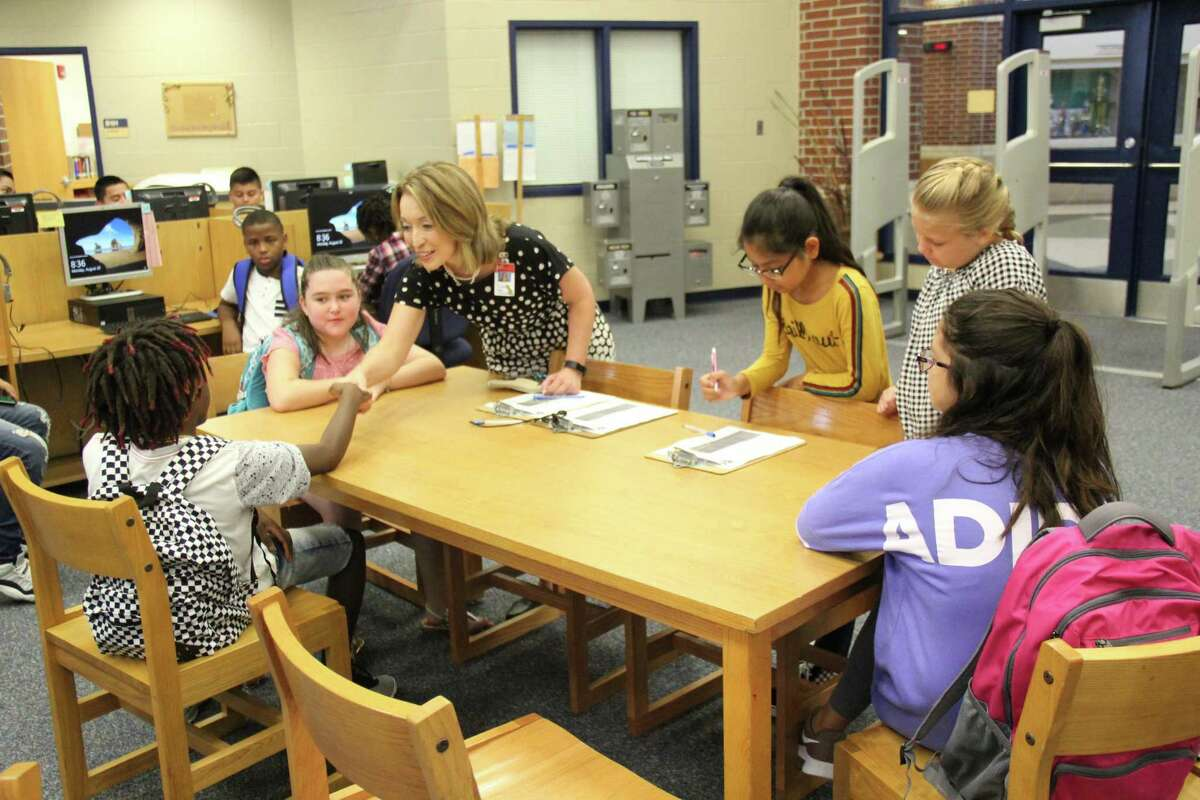 Judson ISD Superintendent Jeanette Ball shakes the hand of a student during the first week of school last August. Ball had become the district's superintendent a month earlier.