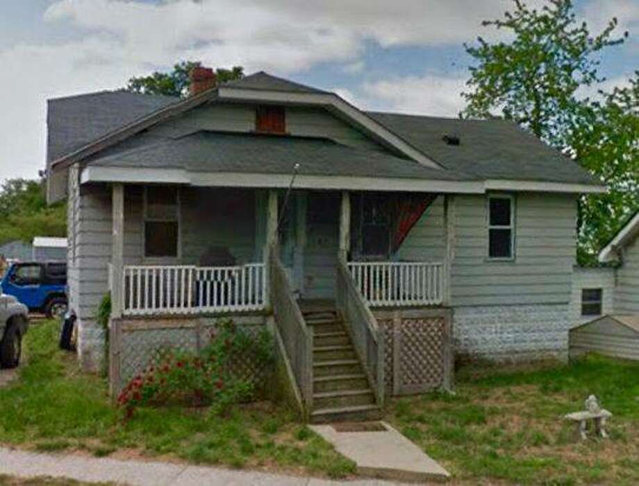 East Alton officials are considering the demolition of four homes, including this one at 107 E. McCasland Ave.