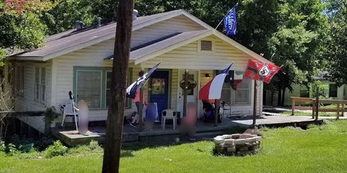 A photo taken Monday of a home in Livingston with Nazi flags hanging outside. At least one family in the area say they want to move because of the flags.