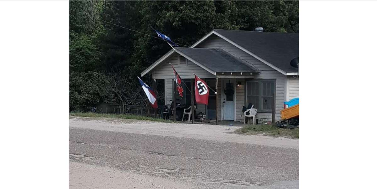 A photo taken May 17 of a home in Livingston with Nazi flags hanging outside. At least one family in the area say they want to move because of the flags.