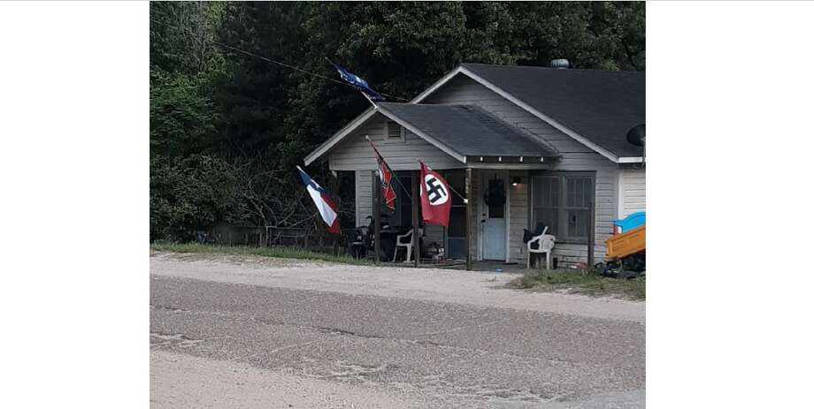 You really can't ignore it': Nazi flags spotted outside home