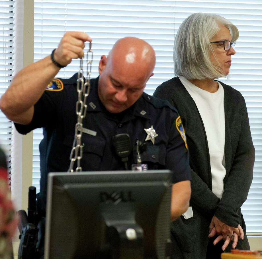 Terri Jaggers is handcuffed after pleading guilty to misdemeanor theft and a third degree felony charge of misapplication of fiduciary property in the 9th state District Court of Phil Grant at the Lee G. Alworth Building, Tuesday. Now the Montgomery County Attorney's Office is seeking civil action against Jaggers and husband Patrick. Photo: Jason Fochtman, Houston Chronicle / Staff Photographer / Houston Chronicle
