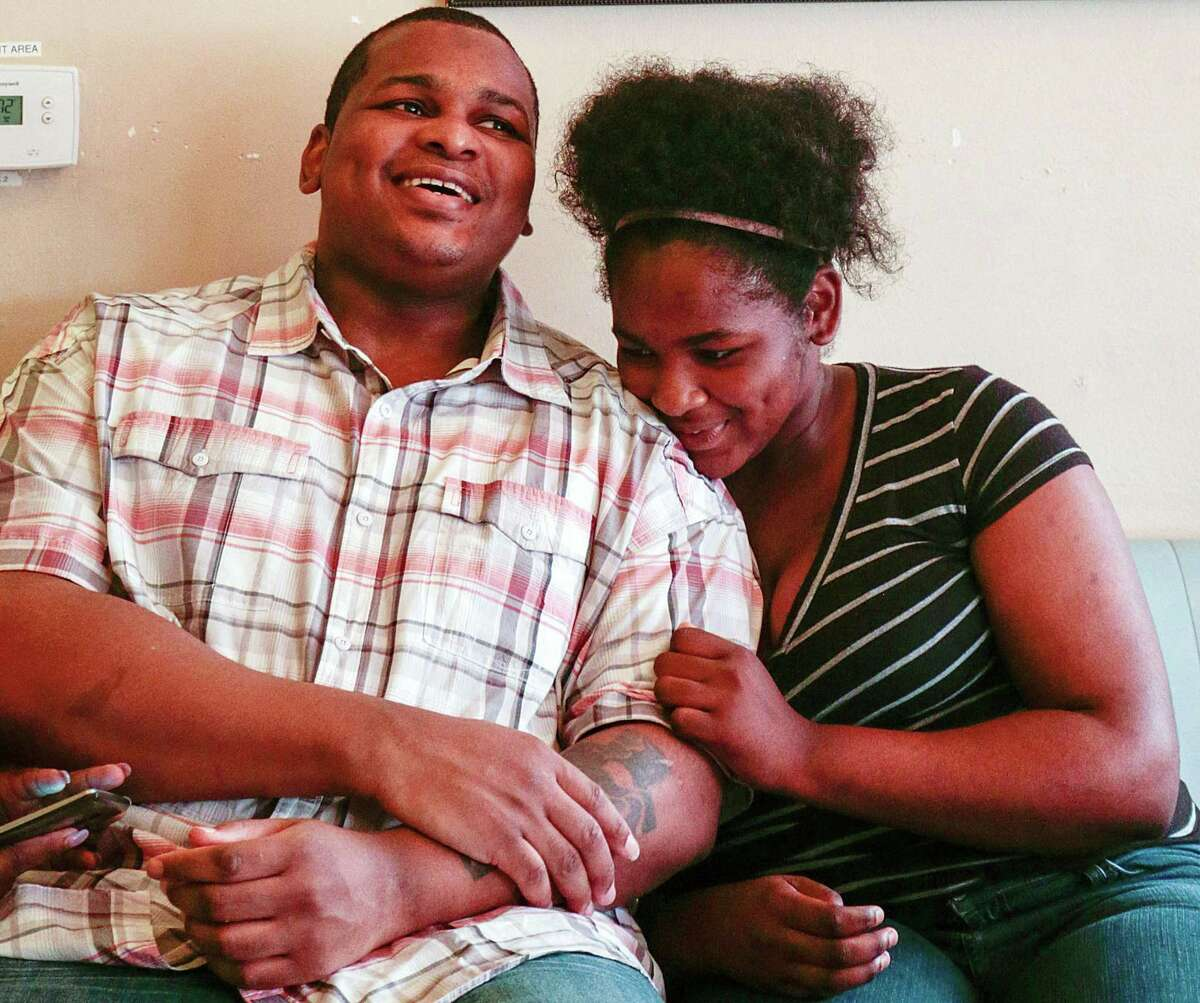 Alfred Brown laughs with his 14-year-old daughter Kiearra Simon before having lunch Tuesday, June 9, 2015, in Houston. Then-Harris County District Attorney Devon Anderson dropped the capital murder charges against Alfred Brown and he was released Monday after spending years on death row. Brown had been sentenced to death in the 2003 killing of Houston police officer Charles Clark.