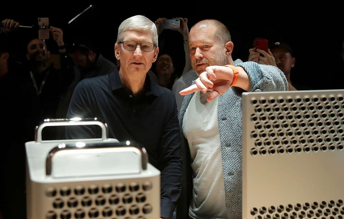 FILE - In this Monday, June 3, 2019 file photo, Apple CEO Tim Cook, left, and chief design officer Jonathan Ive look at the Mac Pro in the display room at the Apple Worldwide Developers Conference in San Jose, Calif. On Thursday, June 27, 2019, Apple said that Ive, chief design officer, will be leaving after more than two decades at the company to start his own firm. (AP Photo/Jeff Chiu)