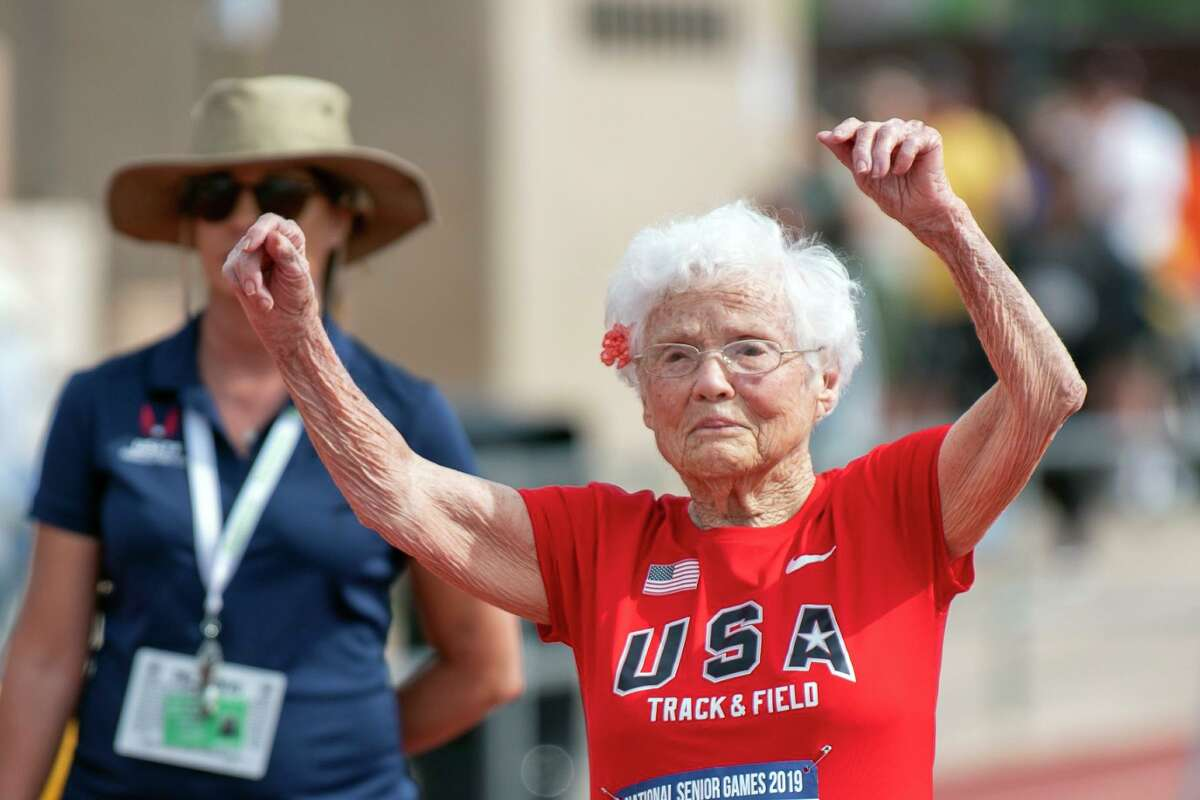 In this photo provided by the National Senior Games Association, 103-year-old Julia Hawkins, of Baton Rouge, La., celebrates after completing the 50-meter dash at the 2019 National Senior Games in Albuquerque, N.M., June 17.
