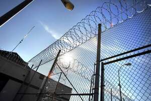 In this Jan. 5, 2012 photo, razor wire tops the fencing at the Polunsky Unit prison in Livingston, Texas. Declines in state prison populations across the country and the shifting politics around mass incarceration have created opportunities to downsize prison bed space. ( Bob Owen/Houston Chronicle via AP)