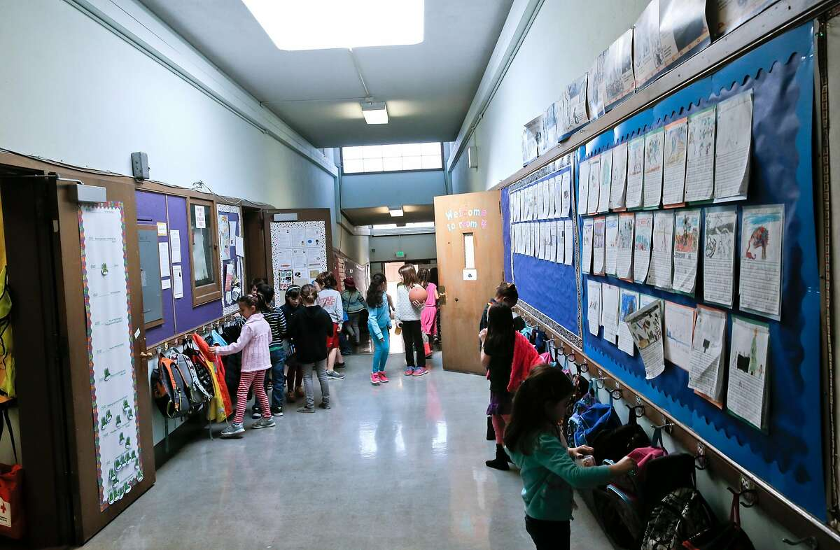 Students fills the hallways as they break for recess at Montclair Elementary School in Oakland, Ca. on Tuesday Feb. 3, 2015. Teachers at several Oakland schools are pressuring the Oakland School district to compensate teachers appropriately during contract negotiations.