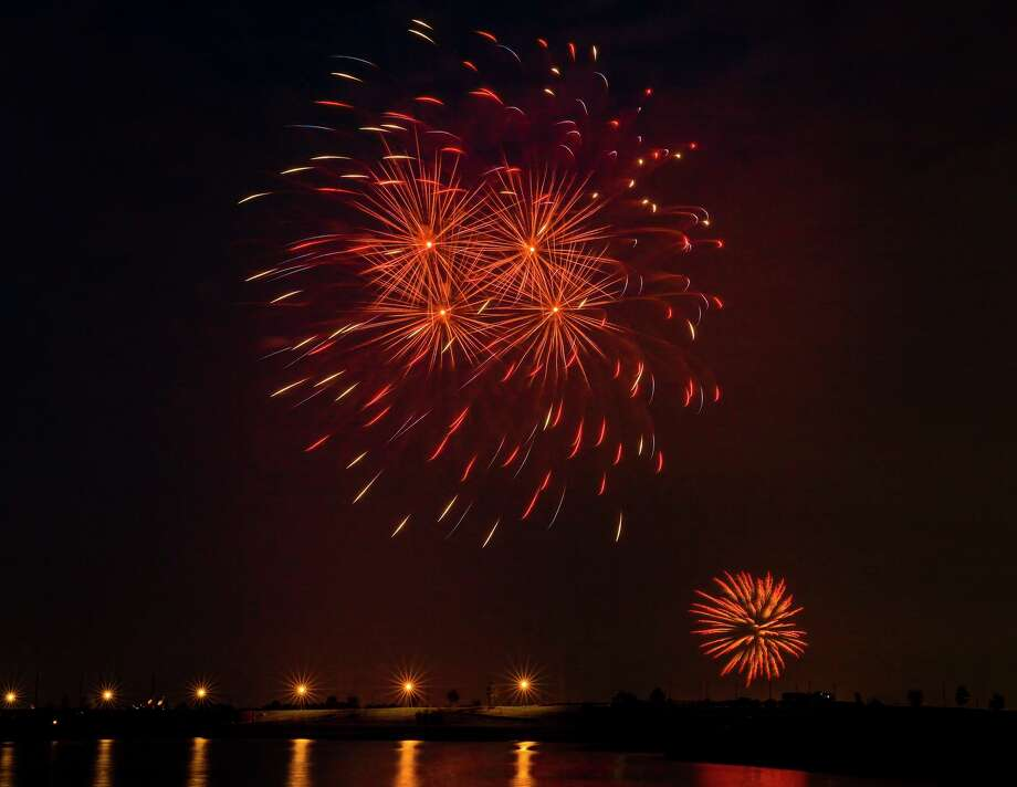 Fireworks light up the sky around Towne Lake in northwest Harris County as the community celebrated the Fourth of July. Photo: Terry Halsey / Submitted Photo / Submitted Photo